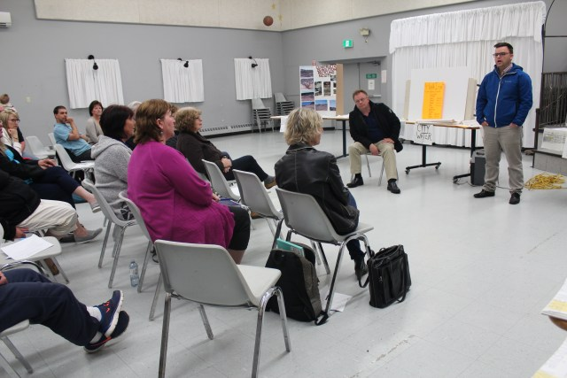 As Coun. Steve Adams listens, Halifax Atlantic MLA Brendan Maguire talks to Harrietsfield residents worried about drinking water quality at a meeting in the area on Thursday. (Rebecca Hussman)