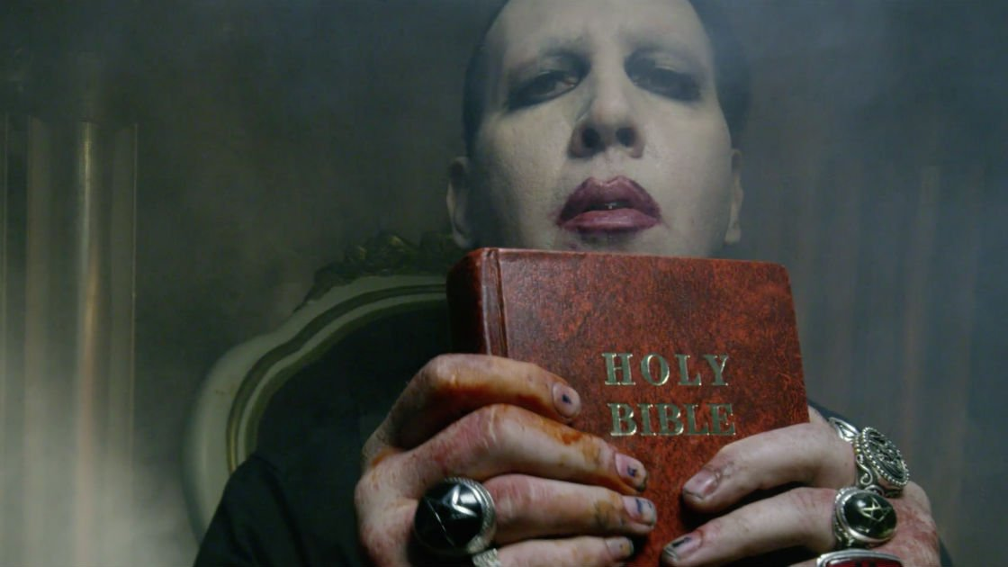 Marilyn Manson clutching the Holy Bible.