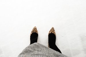 Image of Rebecca standing in a snowstorm in heels.