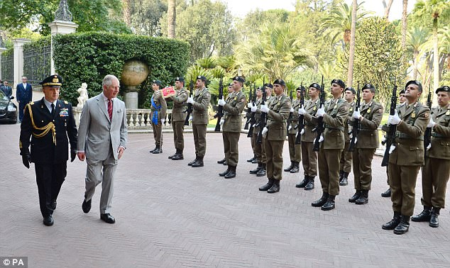 3EF688ED00000578-4382326-The_Prince_of_Wales_inspects_a_Guard_of_Honour_at_the_presidenti-a-16_1491464061349.jpg