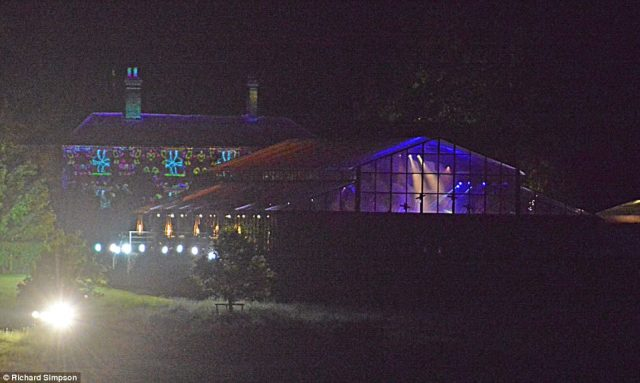 409ACCCE00000578-4527140-Coloured_lights_were_visible_inside_the_enormous_glass_marquee_w-a-61_1495371603833.jpg