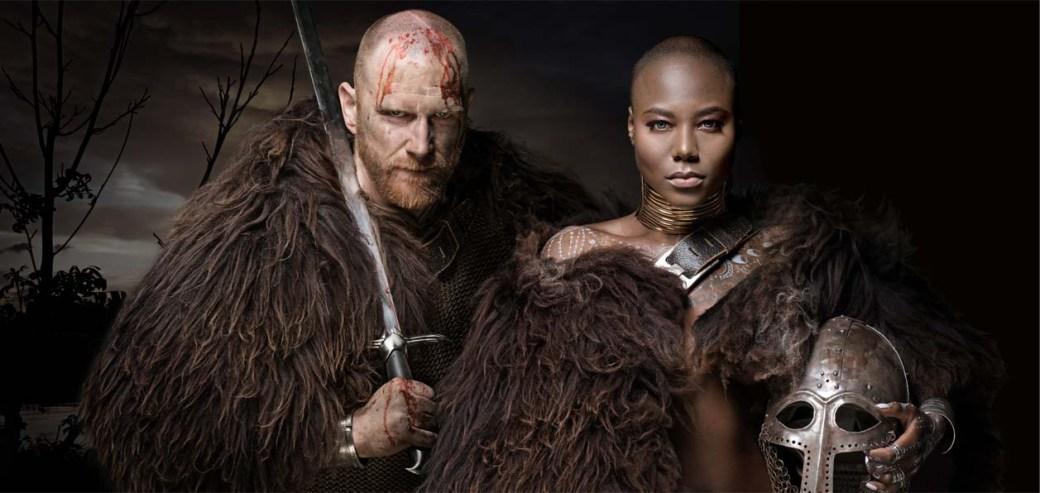 Sword wielding bloody viking soldier with warrior queen