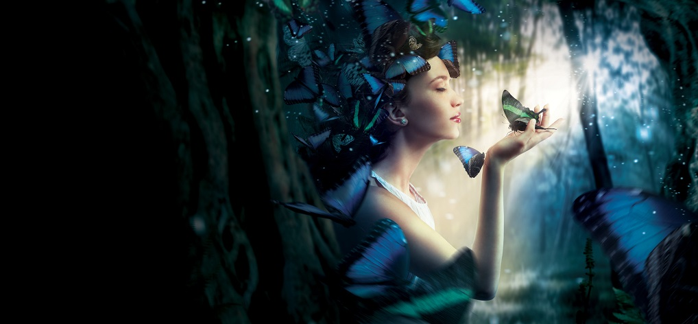 Beautiful woman in the magic forest