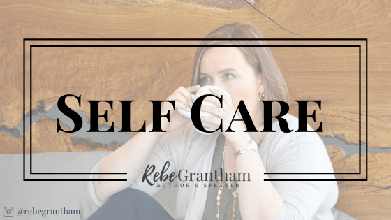 "photo of me drinking tea sitting up against a live-edge wooden headboard. The words ""self care"" and my logo are superimposed over the image."