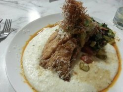 I ordered the special of the day: cornmeal encrusted red snapper with a tomato-avocado salsa over Freeman's Mill grits. The tall stack of goodness is grated sweet potatoes with shavings of fresh Parmesan cheese.