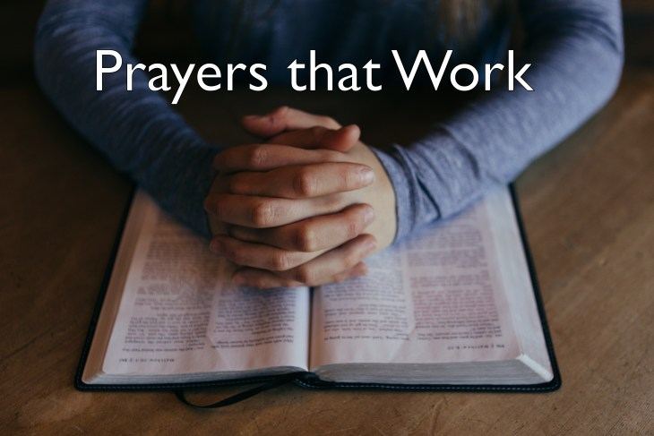 Bible with hands folded in prayer