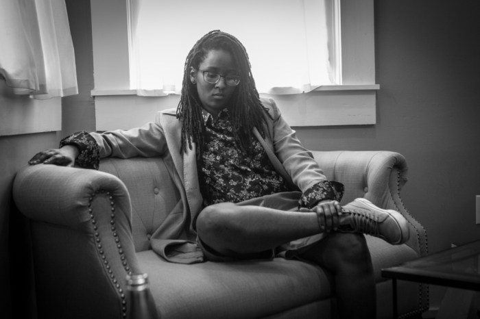 Black and white photo of Princess on a couch with legs crossed