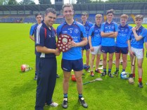 Kevin O'Callaghan presenting shield to winning Captain