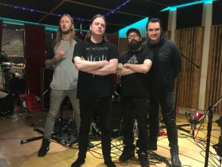 The Haunted band members in the studio
