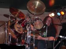 Kevin Smith, evening Rebel Radio DJ, playing the drums