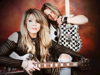 Janet Gardner with her guitar player