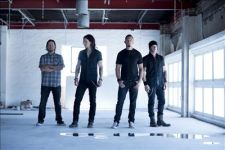 Alter Bridge band standing in a white room with a window to the right side