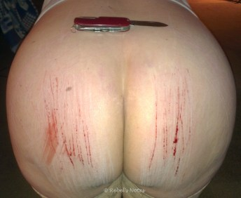 my bottom, a knife and some red lines