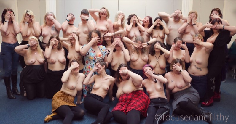 Laughing and covering faces, but baring BOOBS!