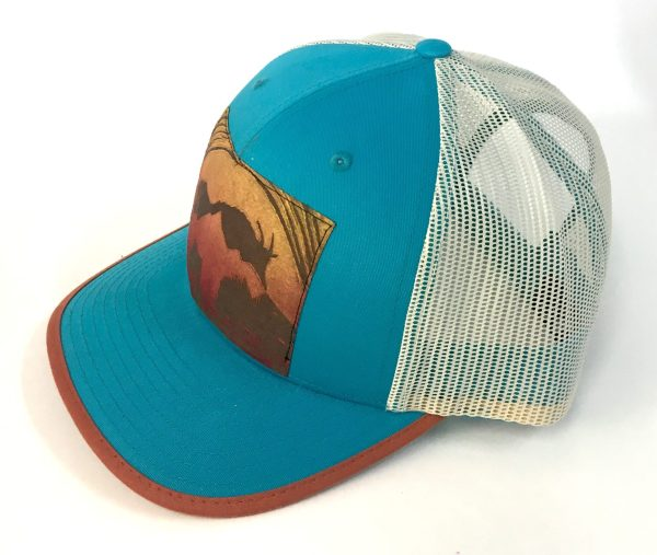 Side view of Bright Blue Cotton Front, Mountain Goat Print hat