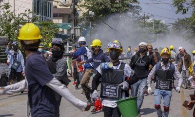 Police in Myanmar raided the homes of protesting railway employees.