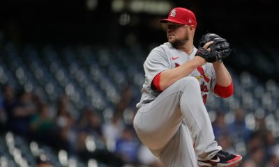 Lester wins 200th, Cards down Brewers for ninth straight win