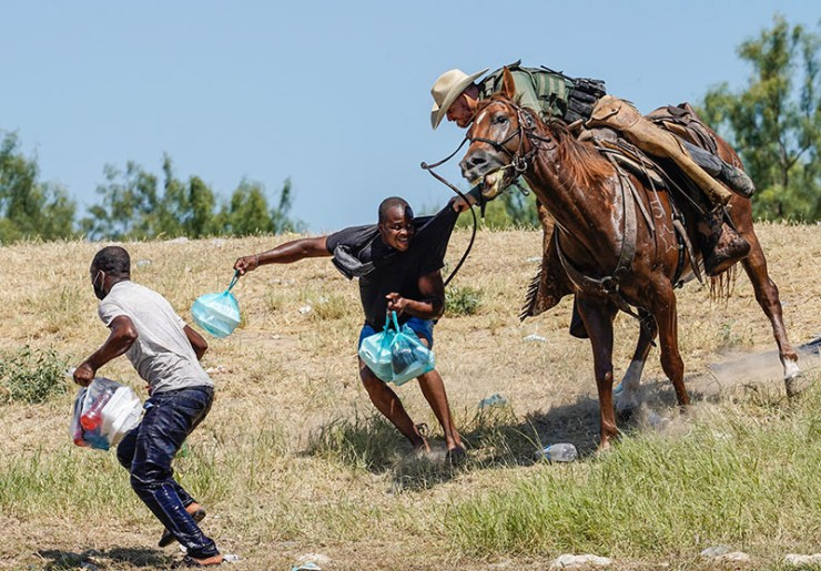 Outrage as border agents on horseback round up Haitians for