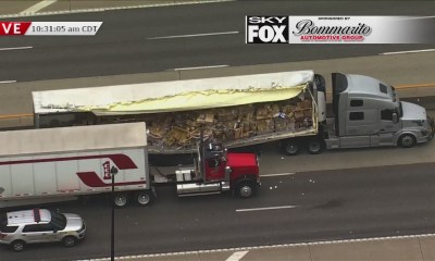Cargo spills from semi after crash closes WB I-70 at T.R. Hughes
