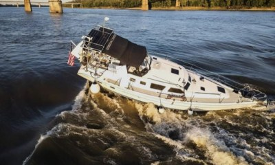 Recovery of boat stuck in Mississippi River too risky says tow crew