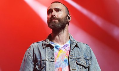 Adam Levine Looks Pissed As Fan Rushes Stage To Hug Him During Live Maroon 5 Show – Watch