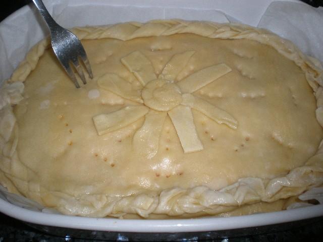 Pinchar empanada boloñesa