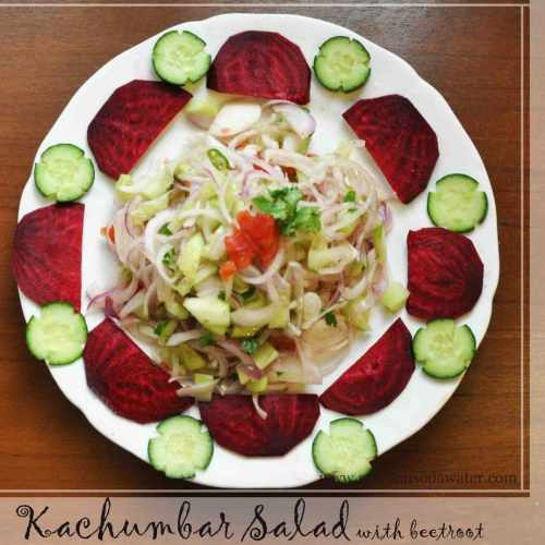 kachumber served in a plate with cucumber flower and beetroot semi circle decorating the plate.