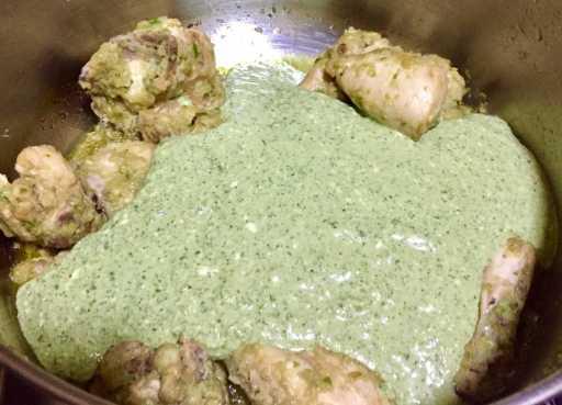 Add Green paste to chicken.