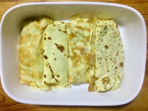 Put all the crepes in baking dish.