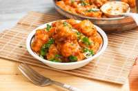 Gobi manchurian served in a bowl with fork.