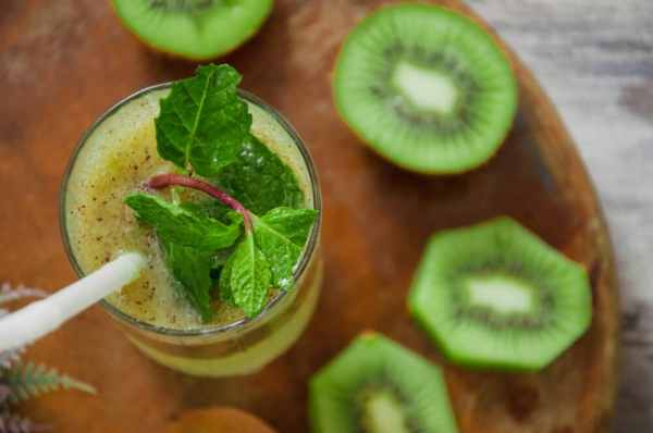 Top view of kiwi juice served in glass.