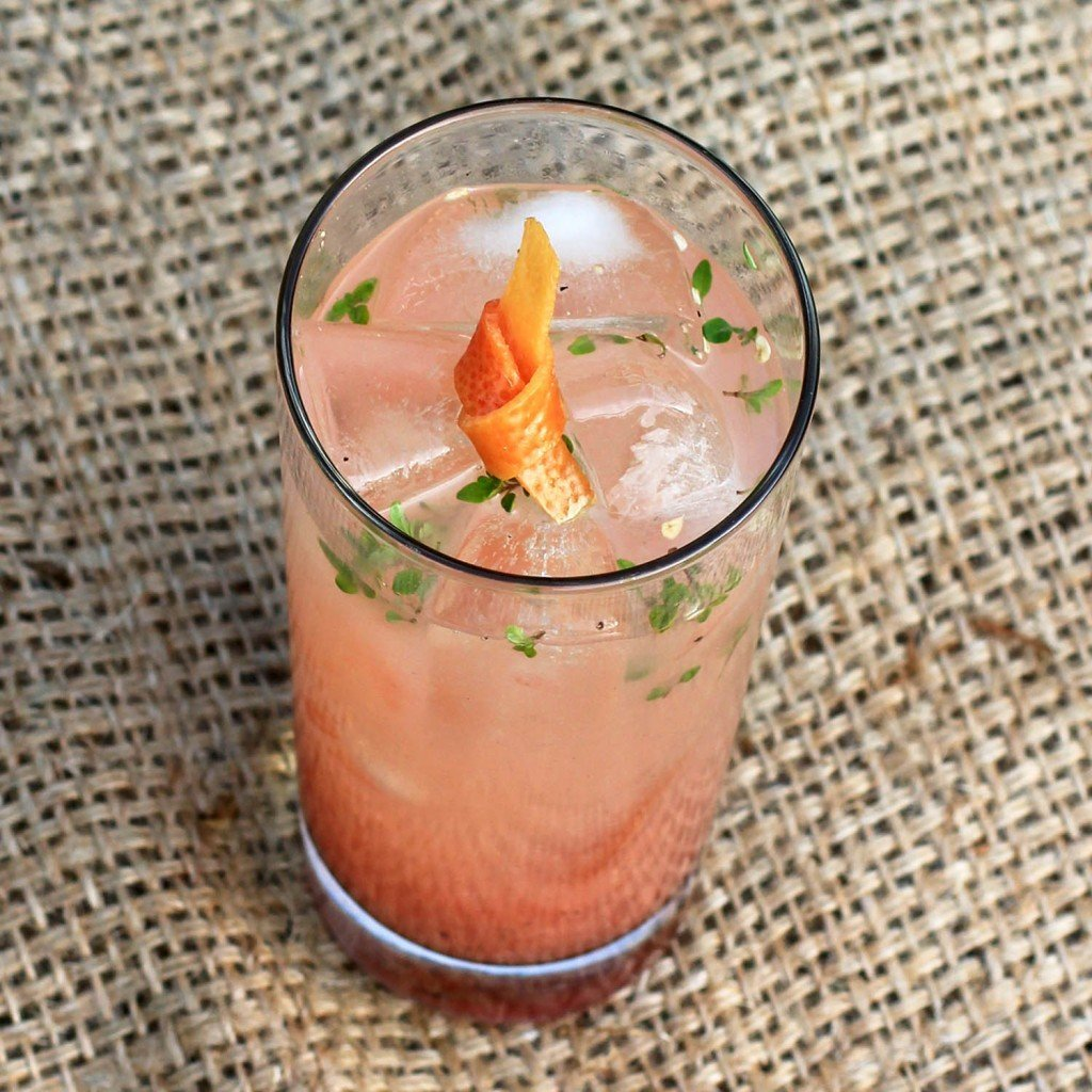 gin and pink grapefruit juice with thyme and black pepper