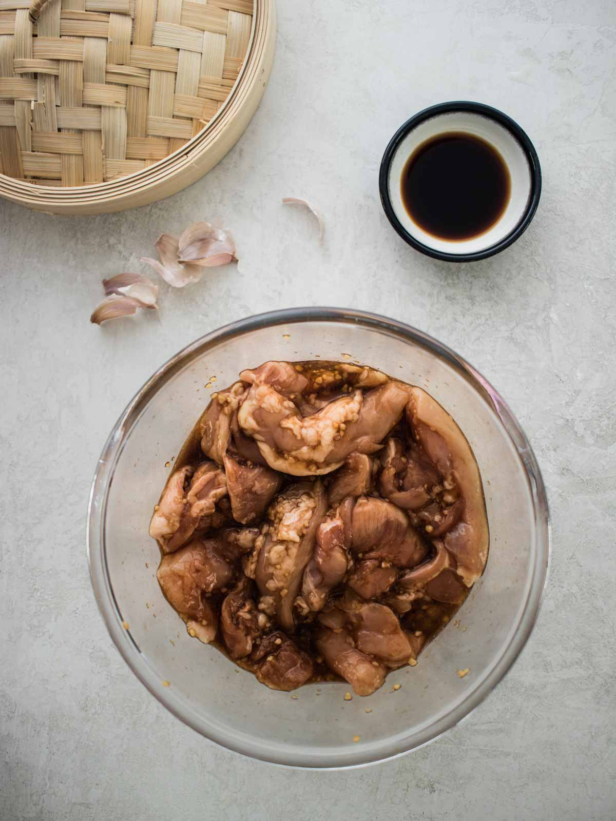 Chicken marinating in a bowl
