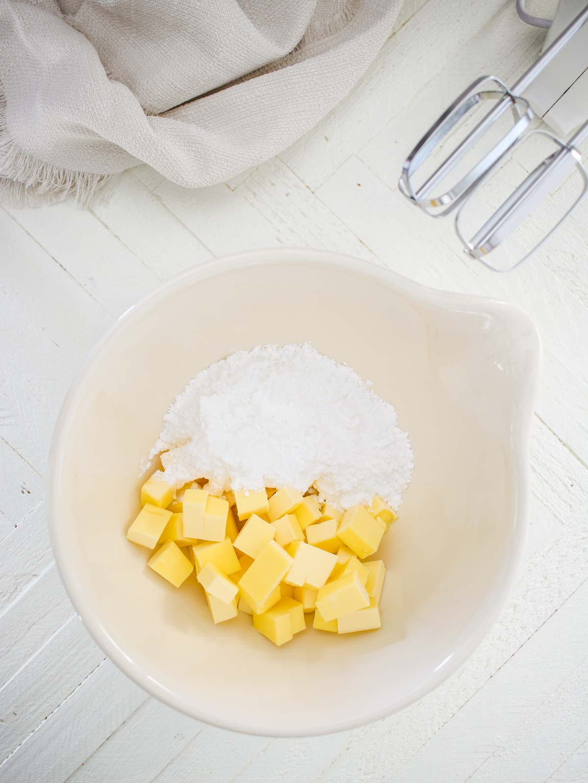 Butter and powdered sugar in a bowl