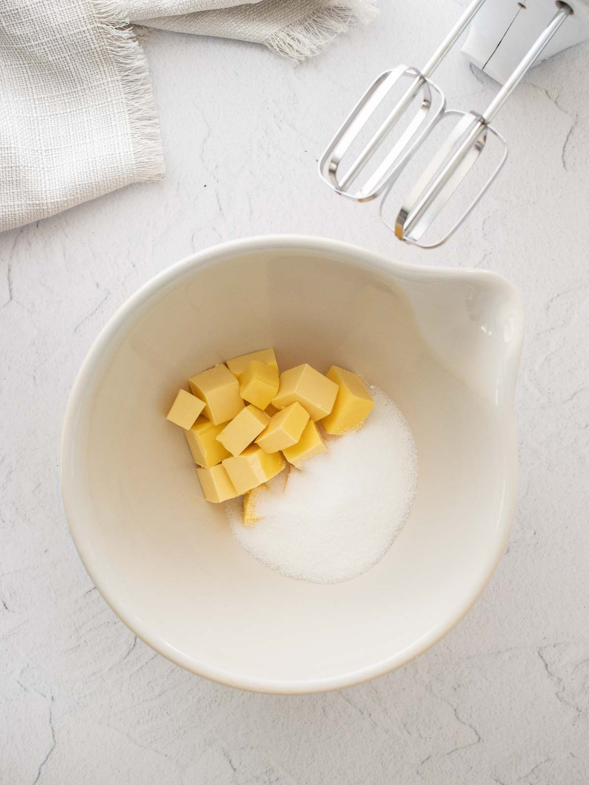 Butter and sugar in a bowl