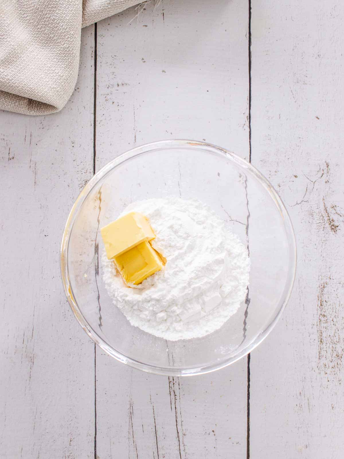 Icing sugar and butter in a bowl