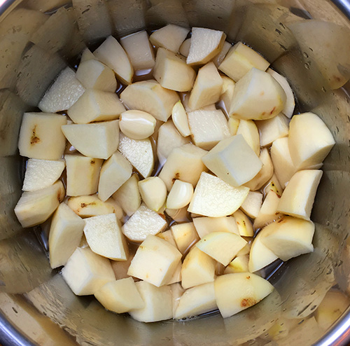 Russet potatoes cut into 1 inch chunks ready to me pressure cooked.