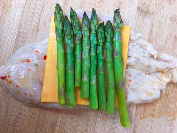 Making asparagus and cheddar stuffed chicken breast