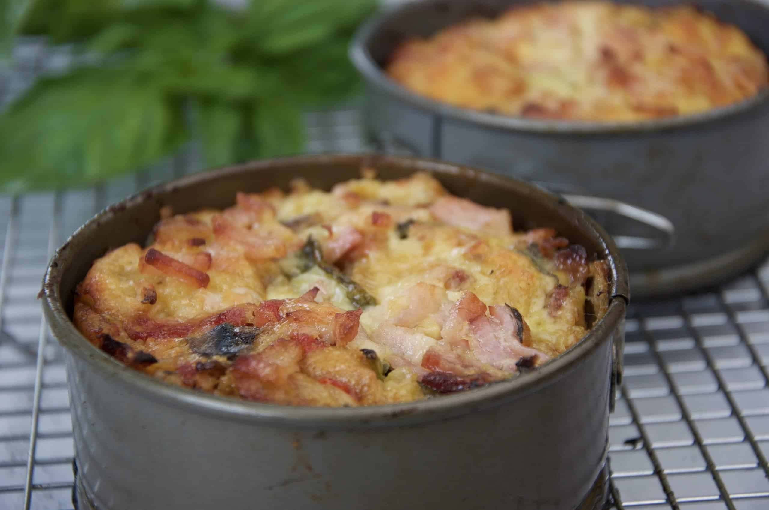 Best breakfast strata - casserole cooling on cake rake with basil in background