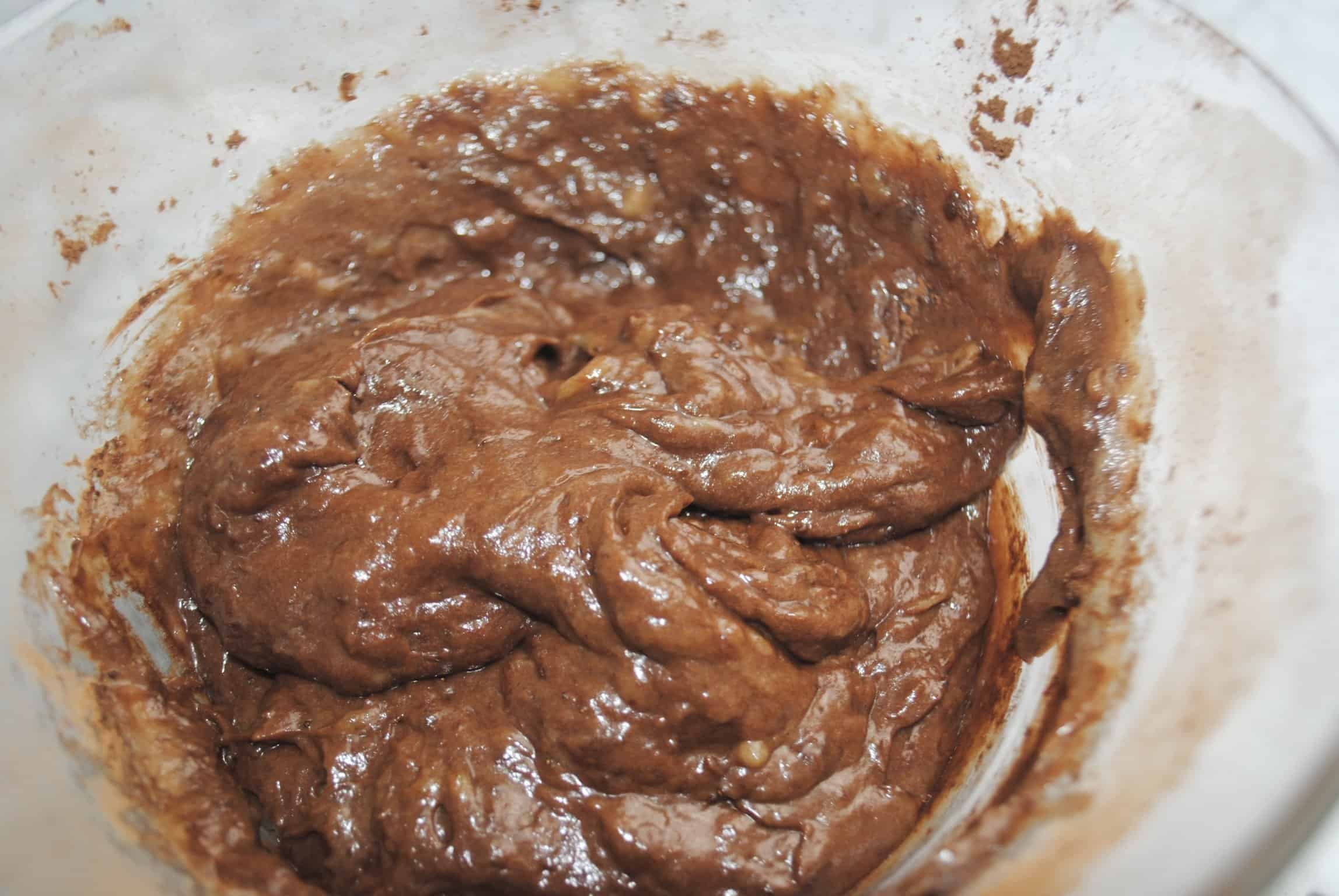 banana bread mixture after adding cocoa in a glass bowl