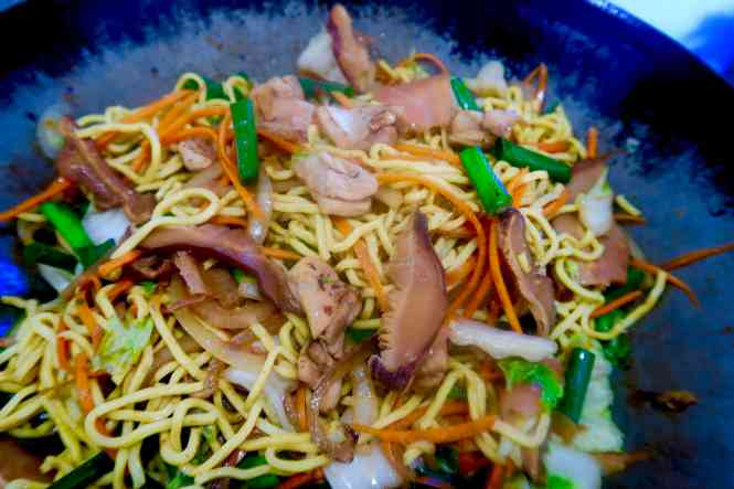 chicken yakisoba cooked in wok ready to serve