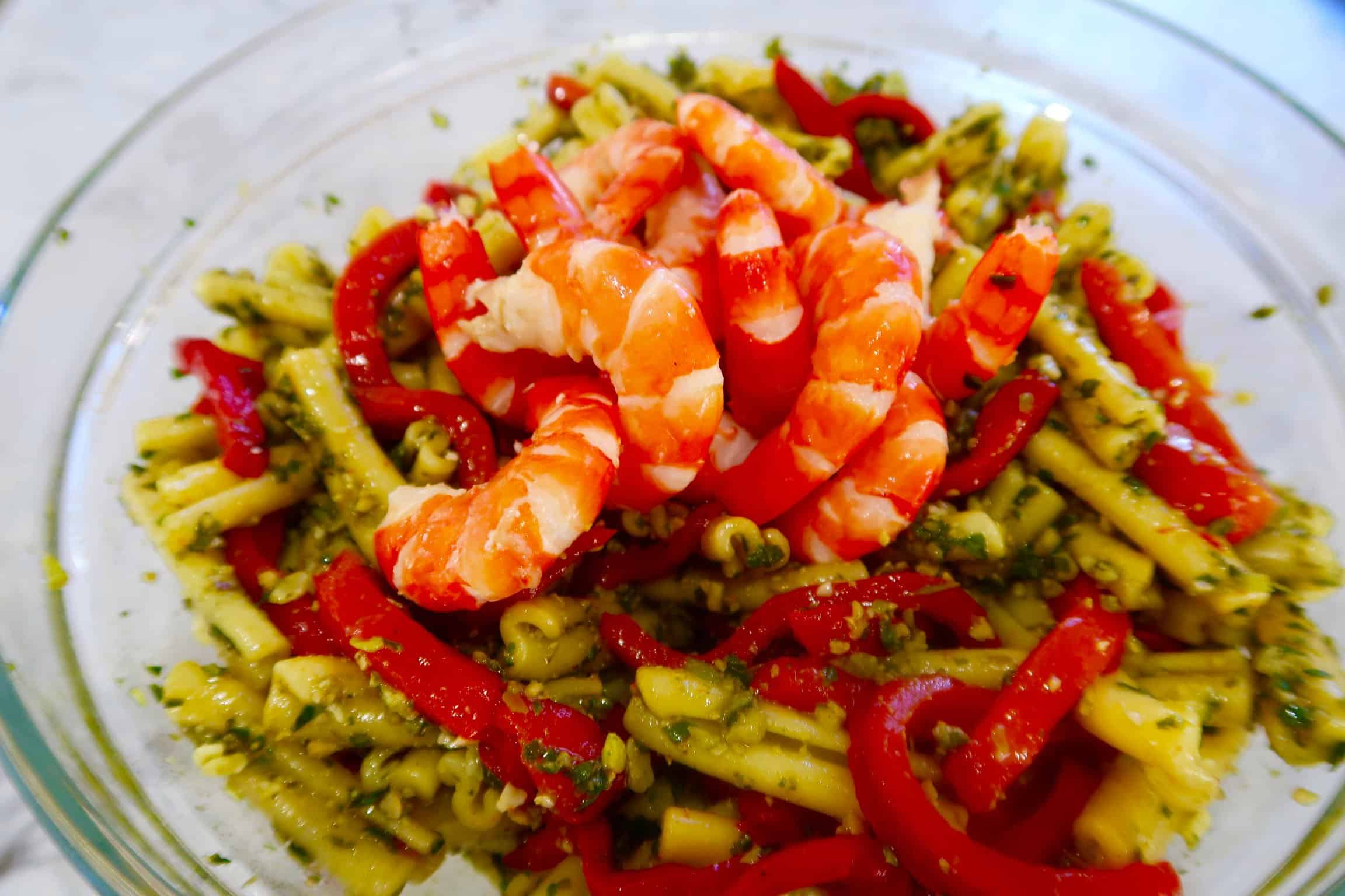 prawn, pesto and chargrilled capsicum pasta ingredients in a glass bowl