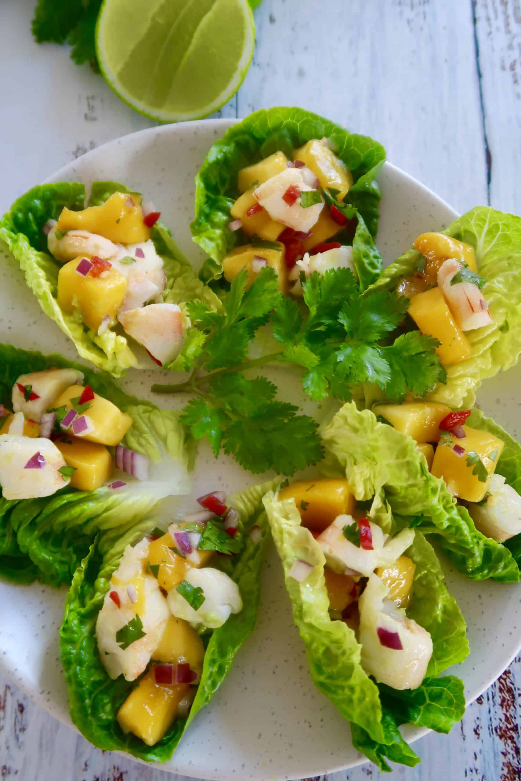 prawn cocktail with mango and avocado stack served on mini lettuce leaves