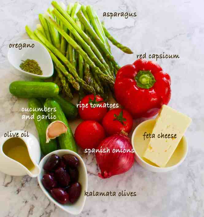 asparagus with greek salad medley ingredients ready to prepare