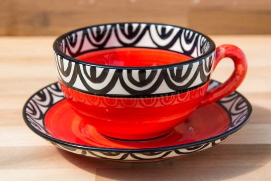 Aztec cup and saucer in red