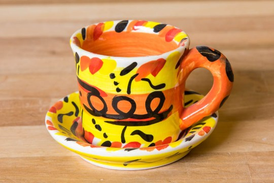 Abstract espresso cup and saucer in Yellow