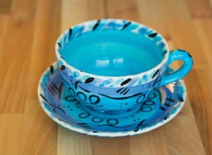 Abstract cup and saucer in blue