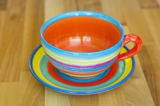 horizontal stripey cup and saucer in candy