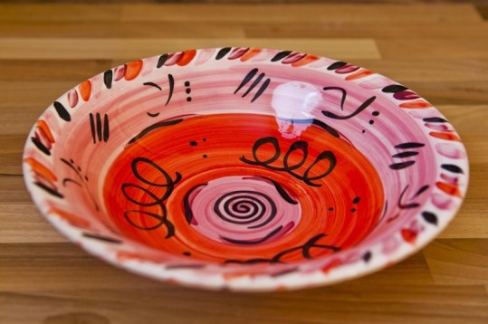 Abstract salad/fruit bowl in red