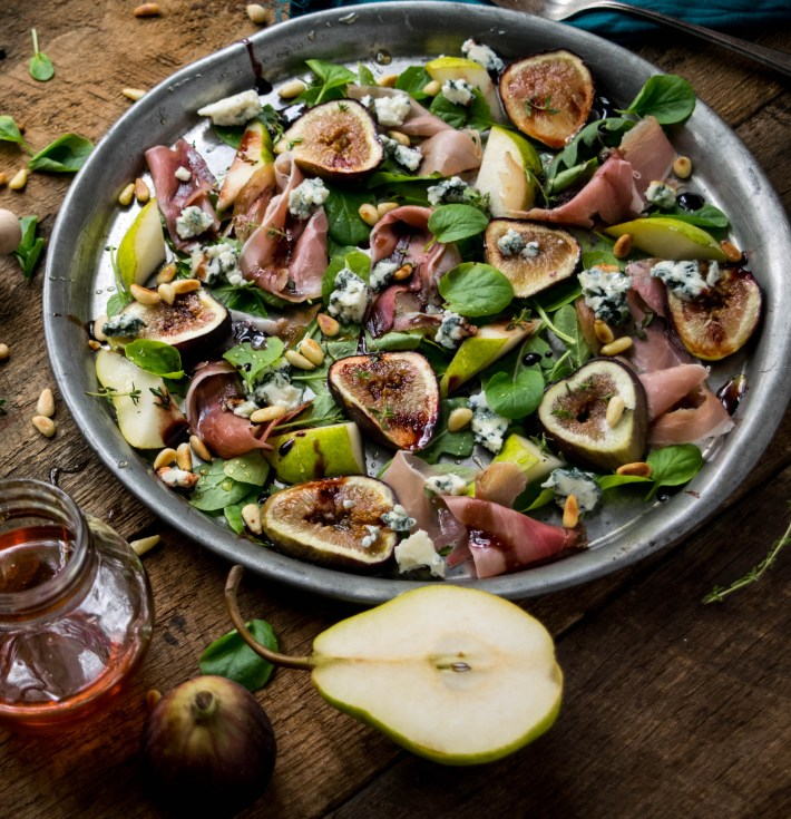 Fig Salad with Prosciutto, Toasted Pine Nuts, and Honey Red Wine Reduction